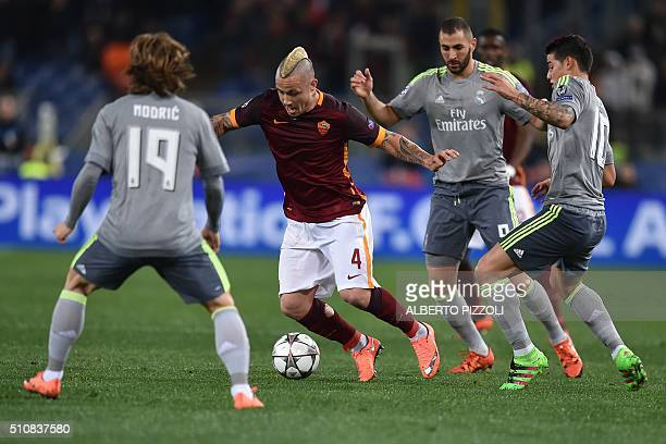 Roma's midfielder from Belgium Radja Nainggolan fights for the ball with Real Madrid's Croatian midfielder Luka Modric and Real Madrid's French...