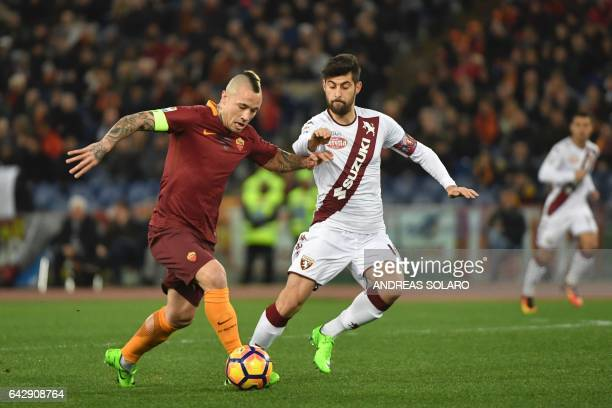 AS Roma's midfielder from Belgium Radja Nainggolan fights for the ball whit Torino's midfielder from Italy Marco Benassi during the Italian Serie A...