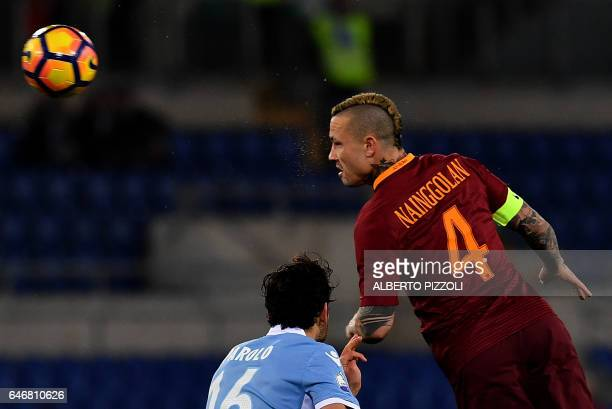 AS Roma's midfielder from Belgium Radja Nainggolan fights for the ball with Lazio's midfielder from Italy Marco Parolo during the Italian TIM Cup 1st...