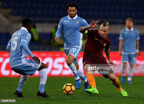 AS Roma's midfielder from Belgium Radja Nainggolan fights for the ball with Lazio's midfielder from Brazil Felipe Anderson and Lazio's defender from...