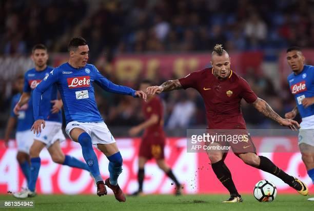 Roma's midfielder from Belgium Radja Nainggolan vies with Napoli Spanish midfielder José María Callejón during the Italian Serie A football match...