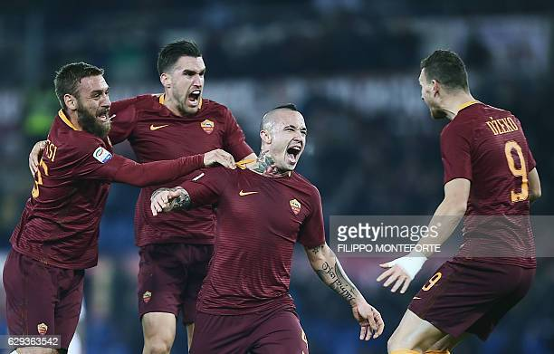 Roma's midfielder from Belgium Radja Nianggolan celebrates after scoring during the Italian Serie A football match Roma vs AC Milan at the Olympic...