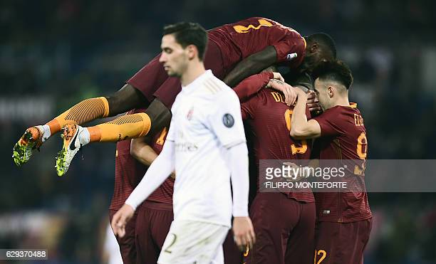 Roma's midfielder from Belgium Radja Nianggolan celebrates with teammates after scoring during the Italian Serie A football match Roma vs AC Milan at...