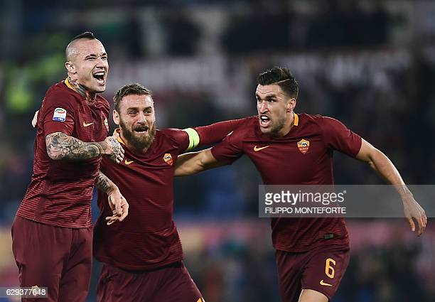 Roma's midfielder from Belgium Radja Nianggolan celebrates with teammates after scoring during the Italian Serie A football match Roma vs AC Milan at...