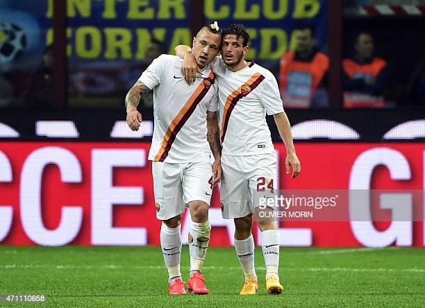 Roma's midfielder from Belgium Radja Nianggolan celebrates with Roma's midfielder Alessandro Florenzi after scoring during the Italian Serie A...