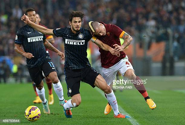 AS Roma's midfielder from Belgium Radja Nianggolan fights for the ball with Inter Milan's defender Andrea Ranocchia during the Italian Serie A...