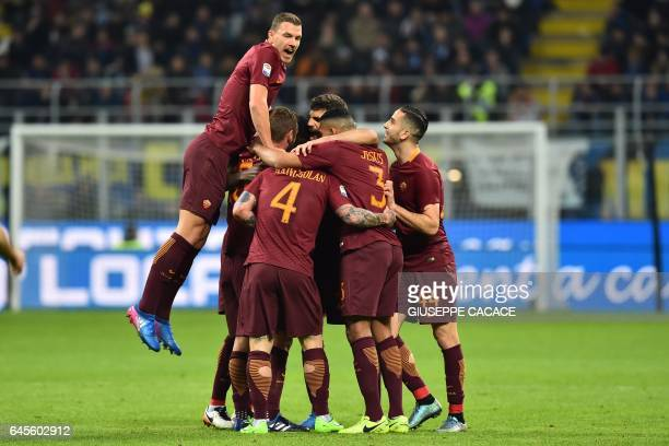 Roma's midfielder from Belgium Radja Nianggolan is congratulated by teammates after scoring a goal during the Italian Serie A football match Inter...