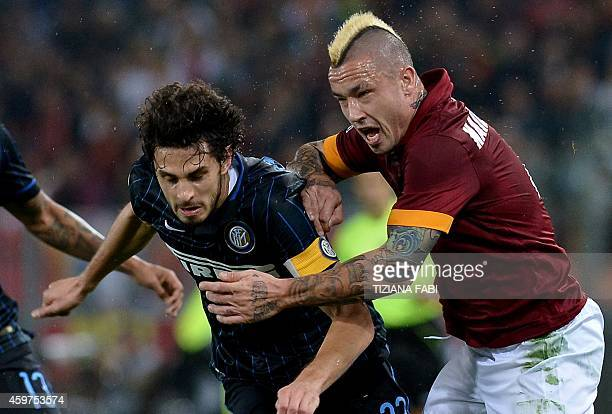 AS Roma's midfielder from Belgium Radja Nianggolan vies with Inter Milan's defender Andrea Ranocchia during the Italian Serie A football match AS...