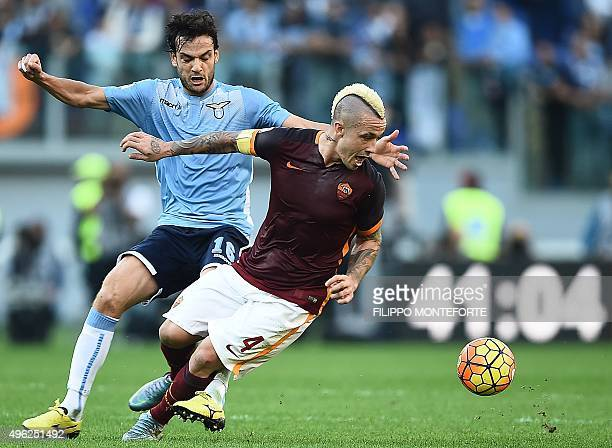 Roma's midfielder from Belgium Radja Nianggolan vies with Lazio's midfielder from Italy Marco Parolo during the Italian Serie A football match AS...