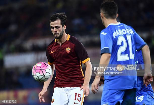 Roma's midfielder from BosniaHerzegovina Miralem Pjanic vies with Empoli's defender from Portugal Mario Rui during the Italian Serie A football match...