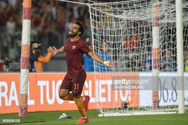 AS Roma's midfielder from Egypt Mohamed Salah celebrates after scoring a goal during the Italian Serie A football match AS Roma vs Crotone on...