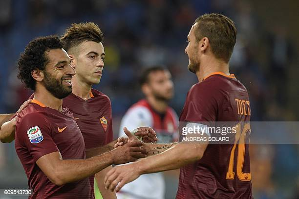 AS Roma's midfielder from Egypt Mohamed Salah celebrates with his teammatesafter scoring a goal during the Italian Serie A football match AS Roma vs...