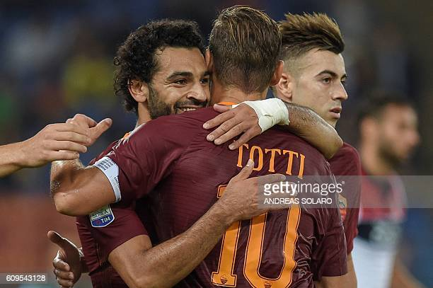 AS Roma's midfielder from Egypt Mohamed Salah celebrates with his teammates after scoring a goal during the Italian Serie A football match AS Roma vs...