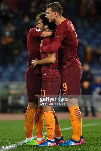 AS Roma's midfielder from Egypt Mohamed Salah celebrates with his teammates after scoring during the Italian Serie A football match AS Roma versus...