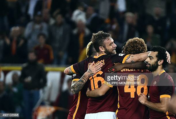 Roma's midfielder from Egypt Mohamed Salah celebrates with teammates after scoring after scoring during the Italian Serie A football match AS Roma vs...