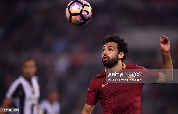 Roma's midfielder from Egypt Mohamed Salah eyes the ball during the Italian Serie A football match Roma vs Juventus on May 14 2017 at Rome's Olympic...