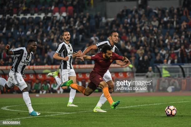 AS Roma's midfielder from Egypt Mohamed Salah runs for the ball during the Italian Serie A football match Roma vs Juventus on May 14 2017 at Rome's...