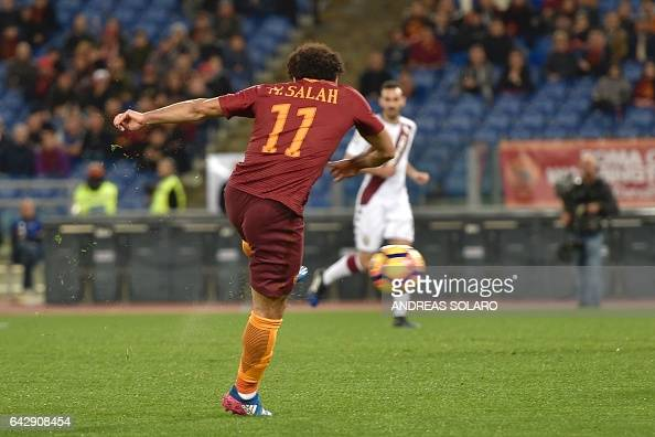 AS Roma's midfielder from Egypt Mohamed Salah shoots and scores during the Italian Serie A football match AS Roma versus Torino on February 19 2017...