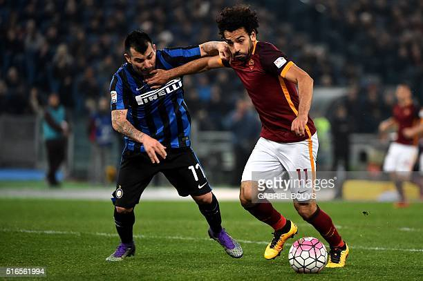 Roma's midfielder from Egypt Mohamed Salah vies with Inter Milan's midfielder from Chile Gary Medel during the Italian Serie A football match between...