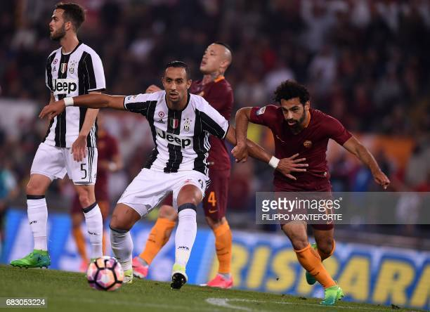 Roma's midfielder from Egypt Mohamed Salah vies with Juventus' midfielder from Germany Sami Khedira during the Italian Serie A football match Roma vs...