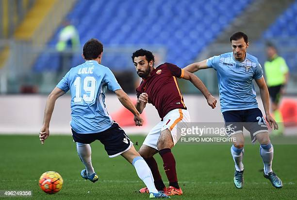 Roma's midfielder from Egypt Mohamed Salah vies with Lazio's midfielder from BosniaHerzegovina Senad Lulic during the Italian Serie A football match...