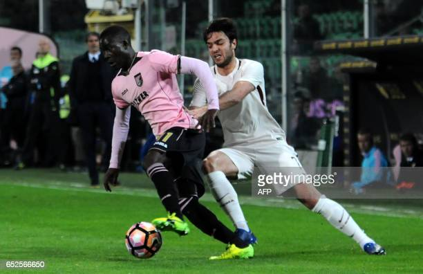 Roma's midfielder from France Clement Grenier vies with Palermo's forward Carlos Embalo during the Italian Serie A football match Palermo vs AS Roma...