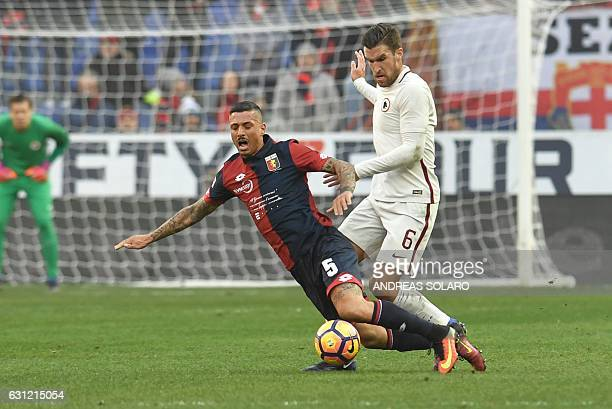 AS Roma's midfielder from Holland Kevin Strootman fights for the ball with Genoa's defender from Italy Armando Izzo during the Italian Serie A...