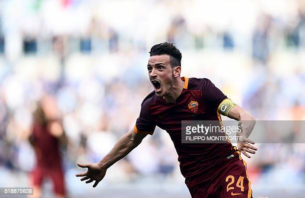 Roma's midfielder from Italy Alessandro Florenzi celebrates after scoring during the Italian Serie A football match Lazio vs AS Roma at the Olympic...