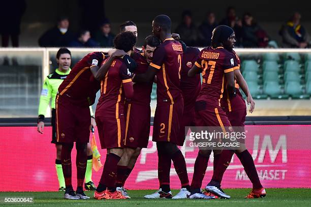 Roma's midfielder from Italy Alessandro Florenzi celebrates with teammates after scoring during the Italian Serie A football match between Chievo...