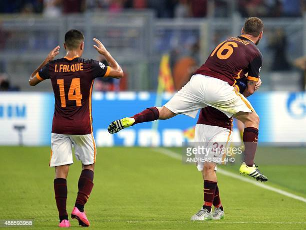 Roma's midfielder from Italy Alessandro Florenzi celebrates with Roma's midfielder from Italy Daniele De Rossi and Roma's forward from Spain Iago...