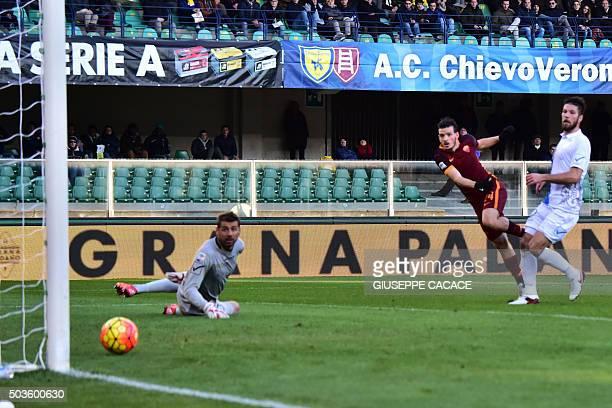 Roma's midfielder from Italy Alessandro Florenzi kicks to score during the Italian Serie A football match between Chievo Verona and AS Roma at...
