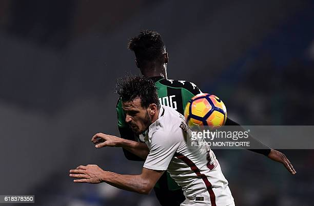 Roma's midfielder from Italy Alessandro Florenzi vies with Sassuolo's forward from Italy Claud Adjapong during the Italian Serie A football match...