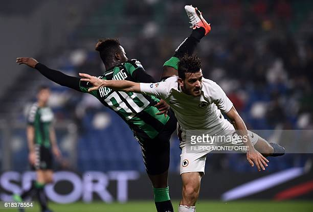 Roma's midfielder from Italy Alessandro Florenzi vies with Sassuolo's forward from Italy Claude Adjapong during the Italian Serie A football match...