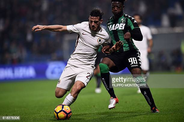 Roma's midfielder from Italy Alessandro Florenzi vies wth Sassuolo's forward from Italy Claud Adjapong during the Italian Serie A football match...