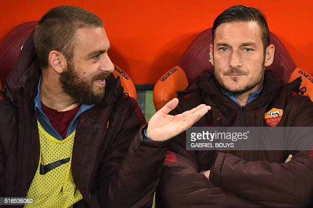 Roma's midfielder from Italy Daniele De Rossi and Roma's forward from Italy Francesco Totti seat on the banch prior the Italian Serie A football...