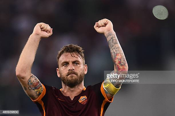 Roma's midfielder from Italy Daniele De Rossi celebrates at the end of the Italian Serie A football match AS Roma vs Juventus on August 30 2015 at...