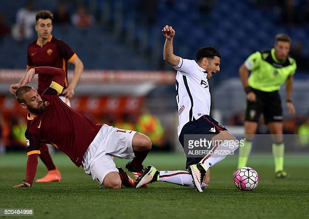 Roma's midfielder from Italy Daniele De Rossi fights for the ball with Bologna's forward Sergio Floccari during the Italian Serie A football match...