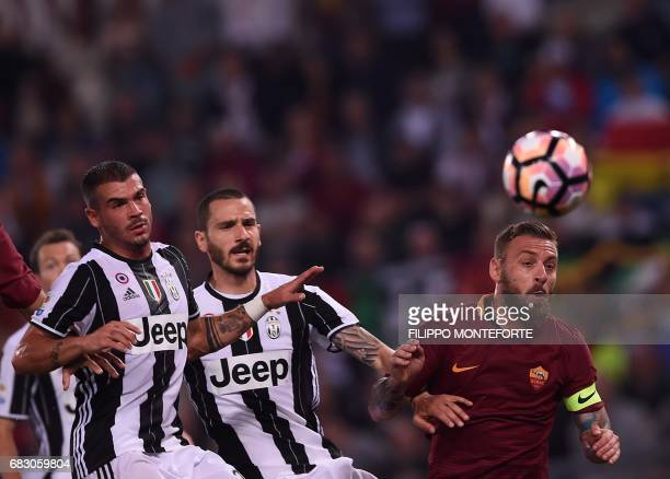 Roma's midfielder from Italy Daniele De Rossi vies with Juventus' defender from Italy Leonardo Bonucci during the Italian Serie A football match Roma...