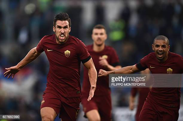Roma's midfielder from Netherlands Kevin Strootman celebrates after scoring during the Italian Serie A football match SS Lazio vs AS Roma on December...