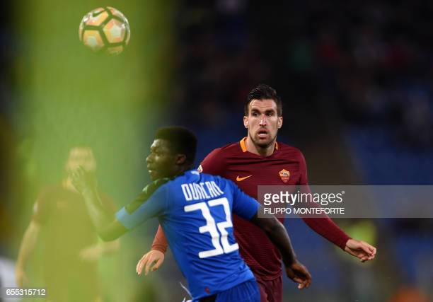 Roma's midfielder from Netherlands Kevin Strootman vies with Sassuolo's midfielder from Ghana Alfred Duncan during the italian Serie A football match...