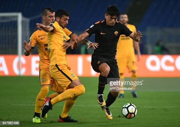 AS Roma's midfielder from Turchia Cengiz Under vies with Verona's midfielder from Italy Mattia Valoti during the Italian Serie A football match AS...