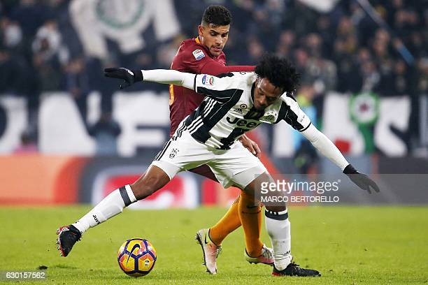 AS Roma's midfielder Gerson of Brazil vies with Juventus' midfielder Juan Cuadrado of Colombia during the Italian Serie A football match Juventus vs...