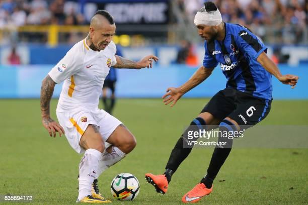 AS Roma's midfielder Radja Nainggolan from Belgium fights for the ball with Atalanta's defender Ervin Zukanovic of Bosnia Erzegovina during the...
