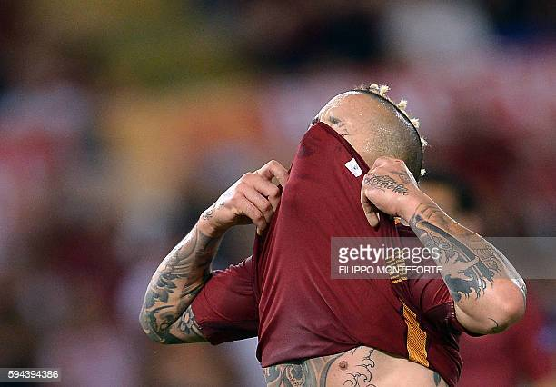 Roma's midfielder Radja Nainggolan of Belgium reacts during the UEFA Champions League second leg play off football match between Roma and Porto at...