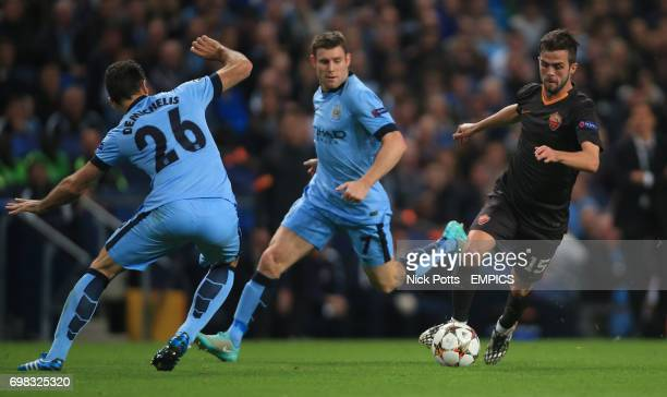 Roma's Miralem Pjanic gets past Manchester City's Martin Demichelis and James Milner