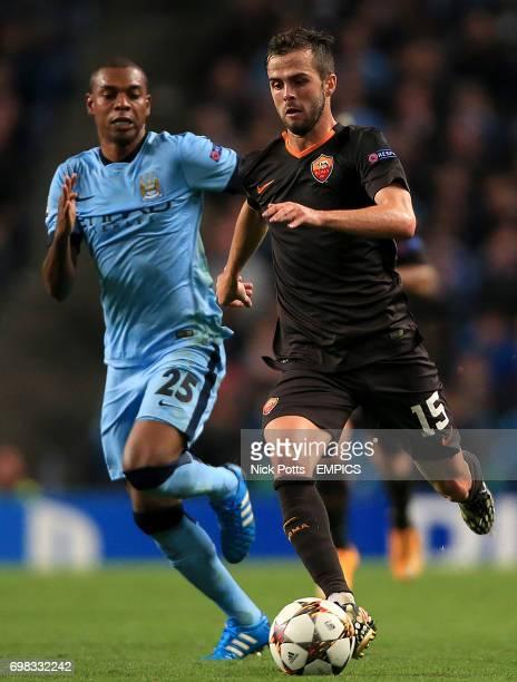 Roma's Miralem Pjanic holds off challenge from Manchester City's Fernandinho