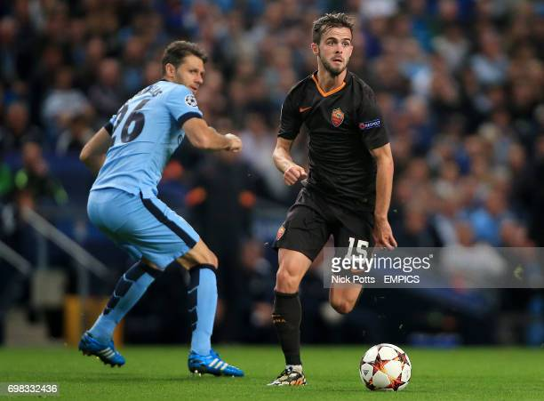 Roma's Miralem Pjanic skips over challenge from Manchester City's Martin Demichelis