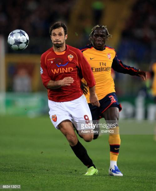 Roma's Mirko Vucinic and Arsenal's Bacary Sagna battle for the ball