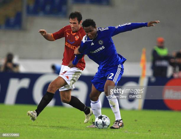 Roma's Mirko Vucinic and Chelsea's John Mikel Obi battle for the ball