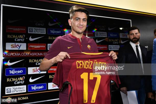 Roma's new Player Cengiz Under poses with his new jersey during a press conference at Fulvio Bernardini Sport Facility in Trigoria district of Rome...